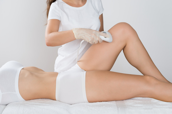 Woman Having Laser Treatment On Thigh